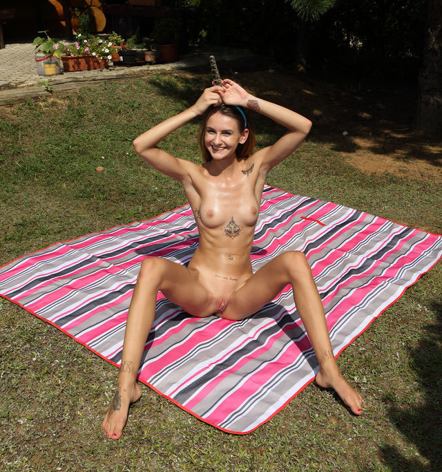 Nude Girl Playing In The Garden