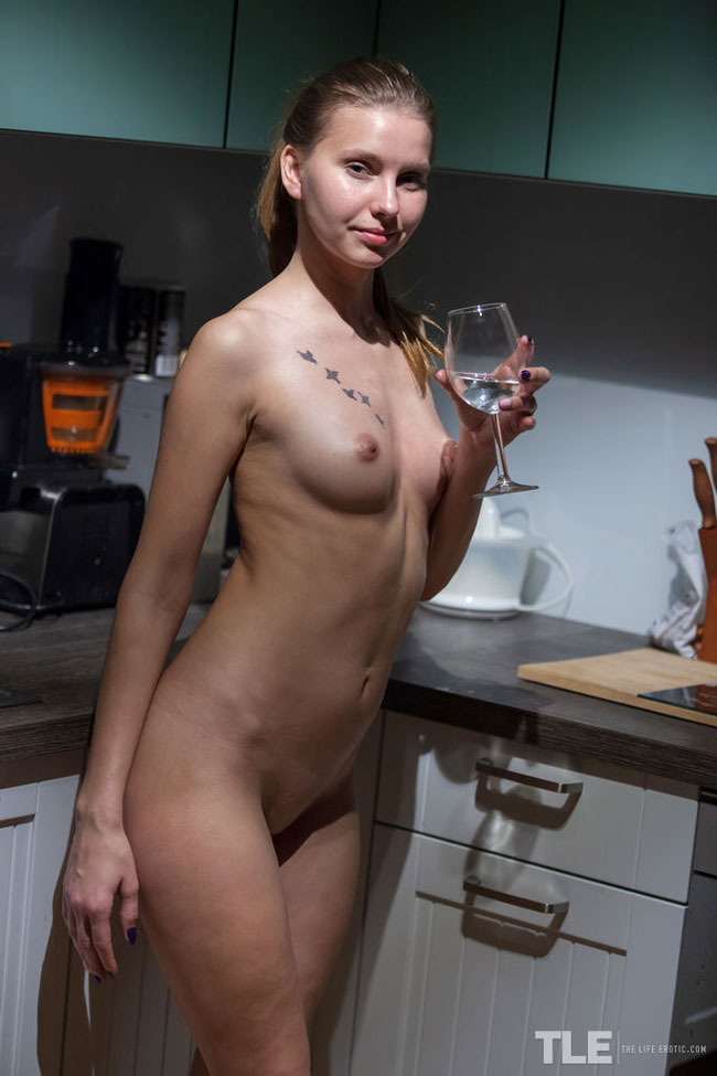 Lara A In The Kitchen Rubbing Her Cunt
