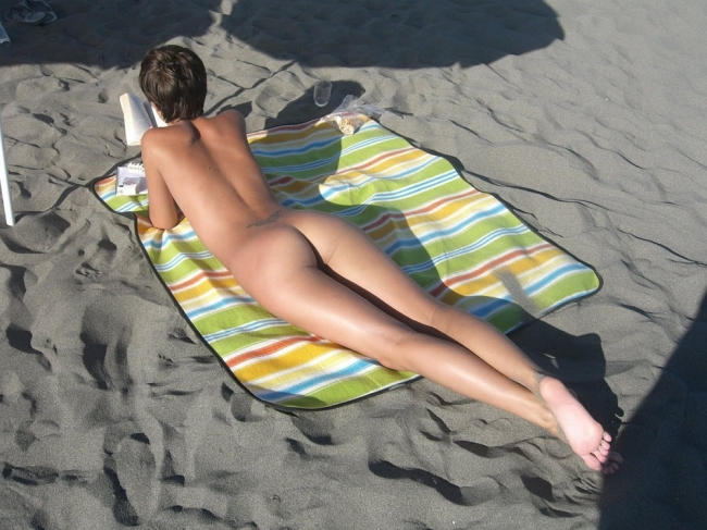 Nudist Girl Reading Book