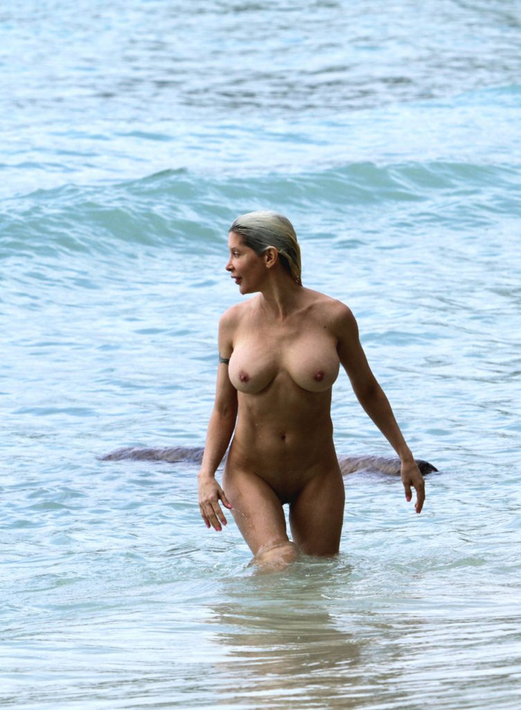 Nudist Girl Frolicking In The Surf
