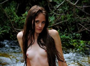 Daniela Posing Naked In River