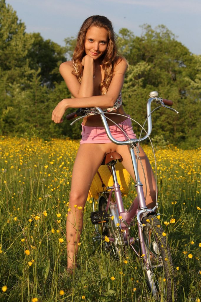 Nudist Babe With Bike