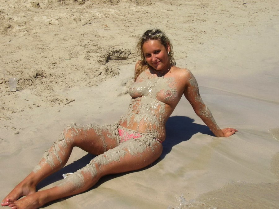 Nudist Girl Playing In Sand