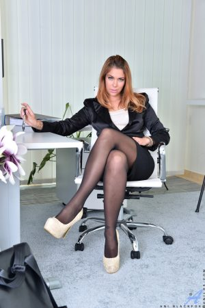 Redhead secretary Ani Blackfox strips and plays with her pussy in the chair