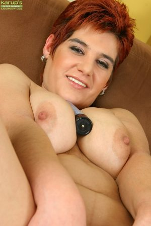 Chubby mature gal with massive jugs and hairy cunt playing with a vibrator