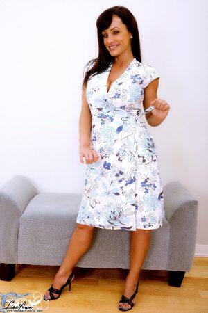MILF Lisa Ann strips her dress & shows her monster curves in her lingerie