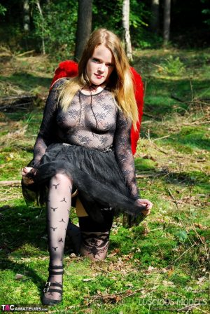 Amateur woman Luscious Models poses in the forest in a cosplay clothing 1