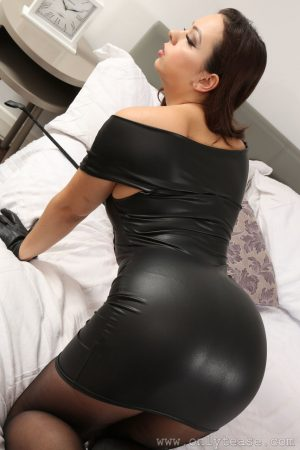 Glamorous Domina Alicia loses tight black dress and poses in pantyhose