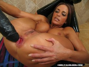 Flexible girl Cheyenne shows a massive dildo up her prolapsed asshole