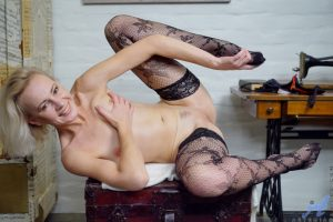 Mature wife Artemia strips to sexy fishnets and flaunts her sexy body