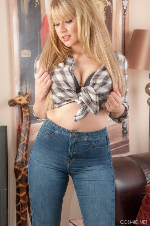 Sweet blonde slut removes her jeans to pose topless in her sexy panties