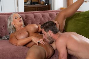 MILF with large silicone tits Alura Jenson deepthroats her stepson's rod