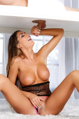 Teen with big tits August Ames gives handjob and a blowjob on massage table