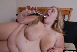 Huge fat chick Christina plays with big fat tits after getting nude