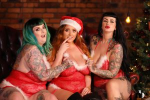 Three big breasted BBWs posing together in their sexy Christmas lingerie