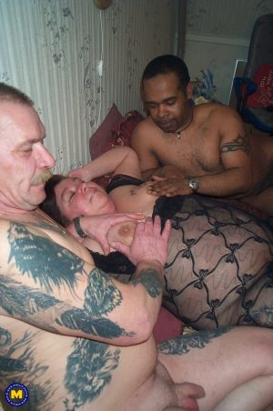Sexy granny with saggy tits Dorine gets pounded by two tattooed men
