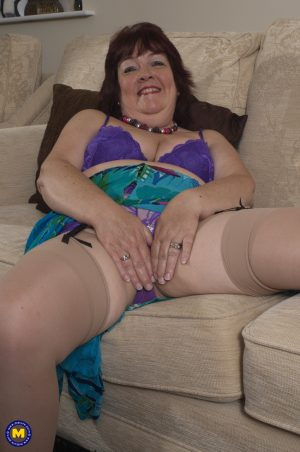 Mature housewife Helen teasing with her saggy tits & dildoing in lingerie