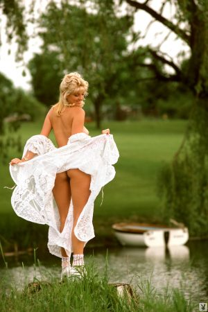 Blonde stunner Lynne Austin in lace exposes big natural tits by the river