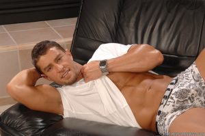 Muscular dude Cody Cummings shows his stiff rod and hot abs on a couch