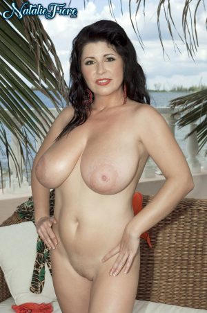 French vixen Natalie Fiore reveals her big melons on the balcony & licks them