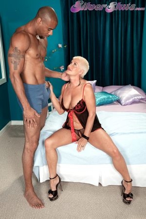 Mature MILF Trinity Powers gets shagged by a black cock before taking a facial