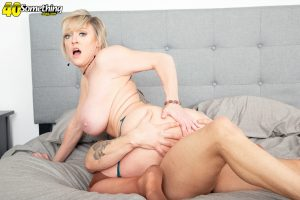 Hot blond cougar Dee Williams seduces her younger lover in a tight dress