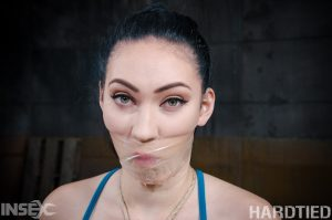 Dark haired girl Aria Alexander is masturbated against her will in rope bonds