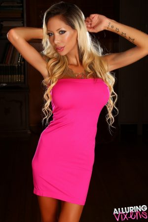 Tattooed girl with long blonde hair Chanel models non nude in a pink dress