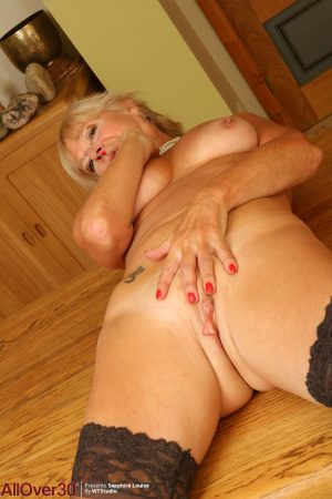 Mature MILF Sapphire Louise takes off her glasses before stripping to hosiery