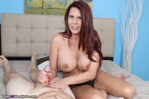 White chick Grace Evangeline bares her huge boobs while giving a handjob 1