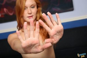 Natural redhead Alex Tanner gets undressed before jerking off a dick
