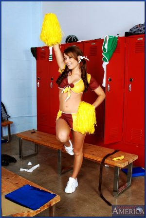 Flirtatious cheerleader babe Jaclyn Case stripping and spreading pussy