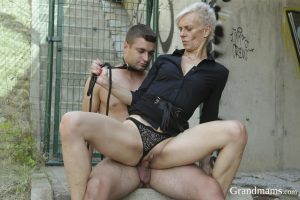 Old granny pleasures her horny pussy with a hard young cock outdoors