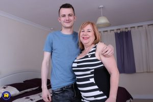 Fat mature redhead gets banged doggystyle in tan nylons by a younger boy