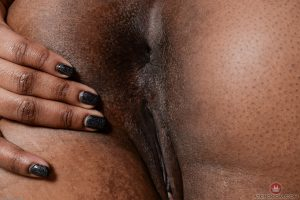African solo model Chanell Heart uncovers her small tits as she disrobes