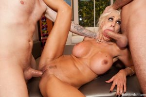 Fantastic blonde cougar Puma Swede gets her holes filled with two knobs