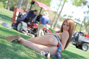 Adorable ginger girl Holly lifts her dress up & stretches her twat in the park
