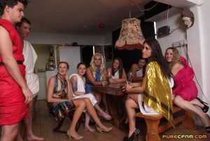 A bunch of dressed up college sluts blow off a cute student at the toga party