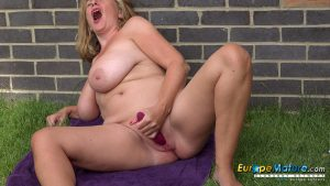 Old granny with big tits strips nude & stretches her muff with a toy outdoors