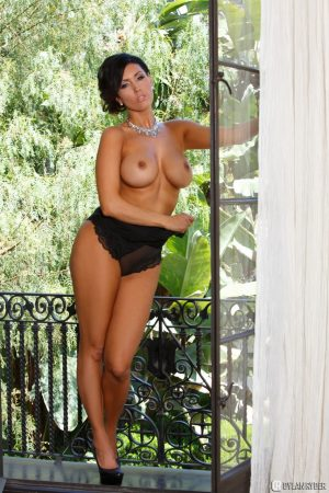 Hypnotizing brunette Sunny Leone in exciting black lingerie on the balcony