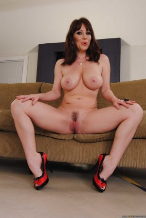 Alluring mature lady RayVeness teases with her incredible boobs & trimmed muff
