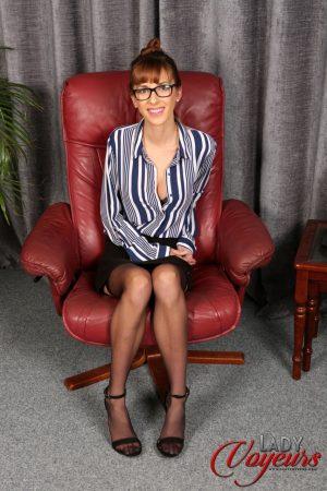 Stunning office lady Ella Rose flashing an arousing upskirt in stockings