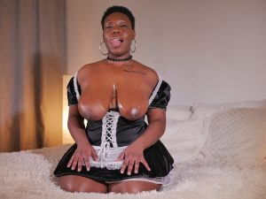Chubby ebony maid Asia Drake exposing her huge saggy tits and black pussy