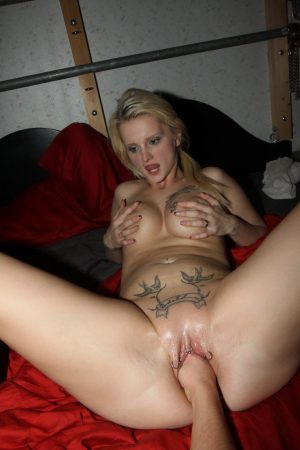 Tattooed blonde Mia Bitch has her pussy fisted and screwed during a hard fuck