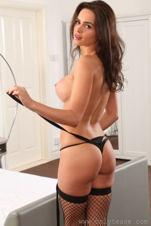 Brunette Adele Taylor strips her sexy corset and poses in nylon body stockings