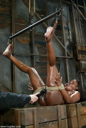 Big boobed ebony MILF Jada Fire gets toyed while hanging from the ceiling
