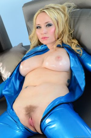 Blonde girl Aiden Starr takes off her latex outfit and shows her big tits 1