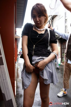 Pretty Japanese chick Ryo Akanishi shows some leg and cleavage while in public