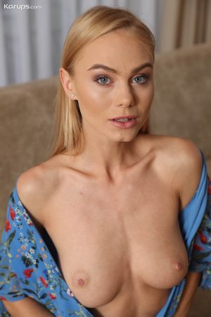 Tall blonde Nancy Ace showcases her bald pussy while modeling in the nude