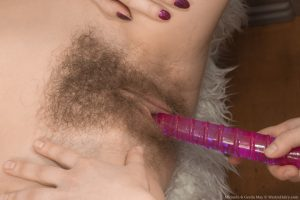 Young beauty Miranda takes part in a hairy lesbian bedroom tribbing romp